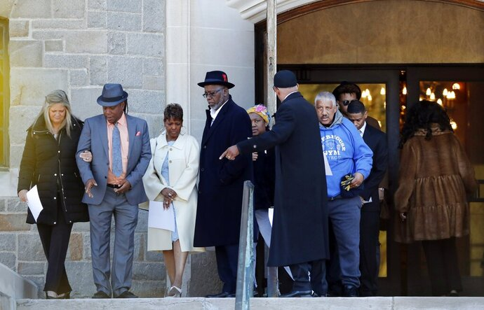 Family members of the late Aretha Franklin gather before entering the Mausoleum Chapel at the Woodlawn Cemetery, Monday, March 25, 2019, in Detroit. Family celebrated Franklin and other passed family members with a memorial service inside a chapel at the cemetery on what would have been the Queen of Soul's 77th birthday. Franklin died last year after battling pancreatic cancer.  Sabrina Owens, Franklin's niece, says
