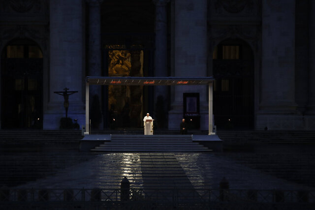 FILE - In this Friday, March 27, 2020 file photo, Pope Francis delivers the Urbi and Orbi prayer (To the City and To the World) in an empty St. Peter's Square, at the Vatican. The pontiff likened the COVID-19 coronavirus pandemic to a storm laying bare illusions that people can be self-sufficient and instead finds