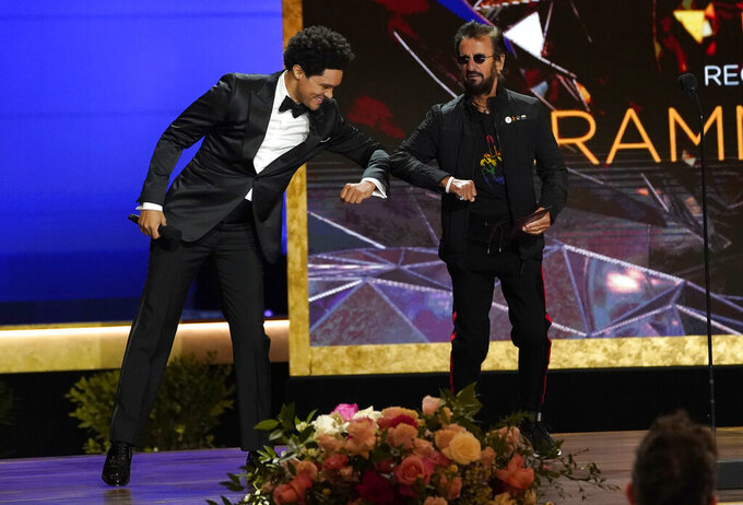 Trevor Noah, left, and host Ringo Starr appear on stage at the 63rd annual Grammy Awards at the Los Angeles Convention Center on Sunday, March 14, 2021. (AP Photo/Chris Pizzello)