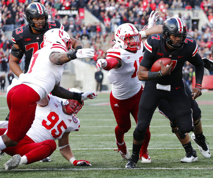 Ohio State quarterback Dwayne Haskins, right, is stopped by Nebraska defenders as he tries to score on a two-point conversion during the second half of an NCAA college football game Saturday, Nov. 3, 2018, in Columbus, Ohio. Ohio State beat Nebraska 36-31. (AP Photo/Jay LaPrete)
