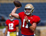 Notre Dame's Jack Coan throws the ball  during NCAA college football practice Thursday, Aug. 19, 2021 at Notre Dame Stadium in South Bend, Ind. (Michael Caterina/South Bend Tribune via AP)