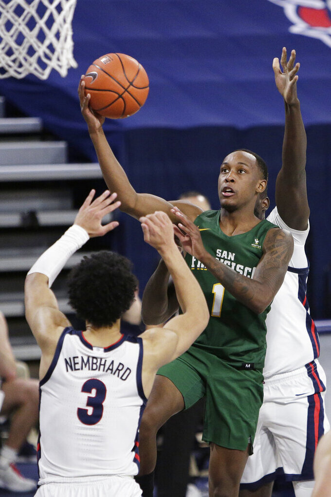 San Francisco guard Jamaree Bouyea (1) shoots over Gonzaga guard Andrew Nembhard (3) during the first half of an NCAA college basketball game in Spokane, Wash., Saturday, Jan. 2, 2021. (AP Photo/Young Kwak)