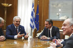 Greek Prime Minister Kyriakos Mitsotakis, second right, meets with Libyan Gen. Khalifa Hifter, second left, in Athens, Friday, Jan. 17, 2020. The commander of anti-government forces in war-torn Libya has begun meetings in Athens in a bid to counter Turkey's support for his opponents. (AP Photo/Petros Giannakouris)