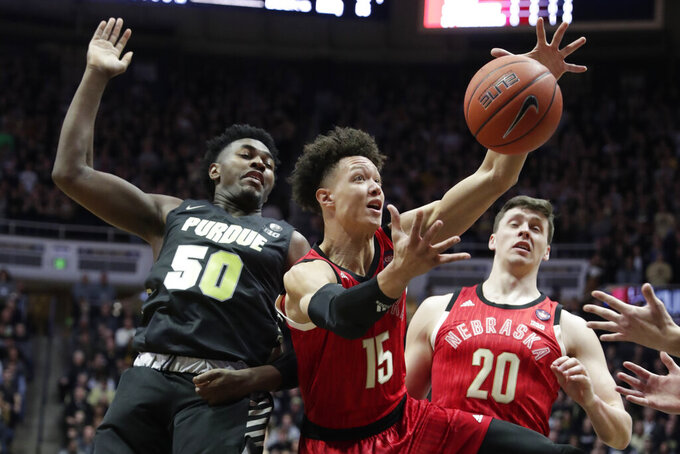 Nebraska forward Isaiah Roby (15) grabs a rebound in front of Purdue forward Trevion Williams (50) and Nebraska forward Tanner Borchardt (20) during the first half of an NCAA college basketball game in West Lafayette, Ind., Saturday, Feb. 9, 2019. (AP Photo/Michael Conroy)