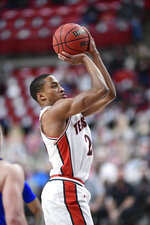 Texas Tech's Nimari Burnett (25) shoots the ball during the first half of an NCAA college basketball game against Kansas in Lubbock, Texas, Thursday, Dec. 17, 2020. (AP Photo/Justin Rex)