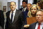 Harvey Weinstein, left, arrives at court for a hearing related to his sexual assault case, Thursday, July 11, 2019,  in New York. Weinstein's lawyer Jose Baez is going to court Thursday to get a judge's permission to leave the case, the latest defection from what was once seen as a modern version of O.J. Simpson's
