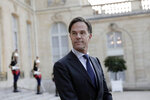FILE - In this Tuesday, Aug. 31, 2021 file photo, Dutch Prime Minister Mark Rutte looks on at the Elysee Palace in Paris. As Europe's economic powerhouse Germany embarks on the task of piecing together a new ruling coalition after the knife-edge election on Sunday Sept. 26, 2021, the country need only look to its neighbors, Belgium and the Netherlands, to see how tricky the process can be. Dutch political leaders resumed meetings this week — again — in a bid to find a constellation of parties willing to rule the country for the next four years. They've been at it — on and off — for more than six months now and no end is in sight. (AP Photo/Lewis Joly, file)