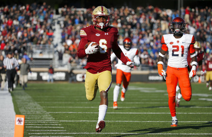 Boston College wide receiver Jeff Smith (6) runs in for a touchdown after catching a pass ahead of Syracuse defensive back Trill Williams (21) during the first half of an NCAA college football game, Saturday, Nov. 24, 2018, in Boston. (AP Photo/Mary Schwalm)