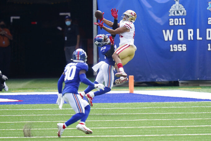San Francisco 49ers' Jordan Reed, right, tries to grab a pass over New York Giants' Logan Ryan during the first half of an NFL football game, Sunday, Sept. 27, 2020, in East Rutherford, N.J. (AP Photo/Corey Sipkin)