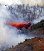 Two planes and a helicopter work on the fire in Parleys Canyon, Saturday, Aug. 14, 2021, in Utah. (Rick Egan/The Salt Lake Tribune via AP)