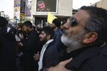 Protesters mourn in a demonstration over the U.S. airstrike in Iraq that killed Iranian Revolutionary Guard Gen. Qassem Soleimani, shown in the screen at rear, in Tehran, Iran, Jan. 3, 2020. Iran has vowed