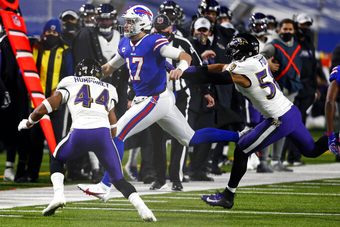 Baltimore Ravens' Marlon Humphrey (44) and L.J. Fort (58) chase Buffalo Bills quarterback Josh Allen (17) during the first half of an NFL divisional round football game Saturday, Jan. 16, 2021, in Orchard Park, N.Y. (AP Photo/Jeffrey T. Barnes)