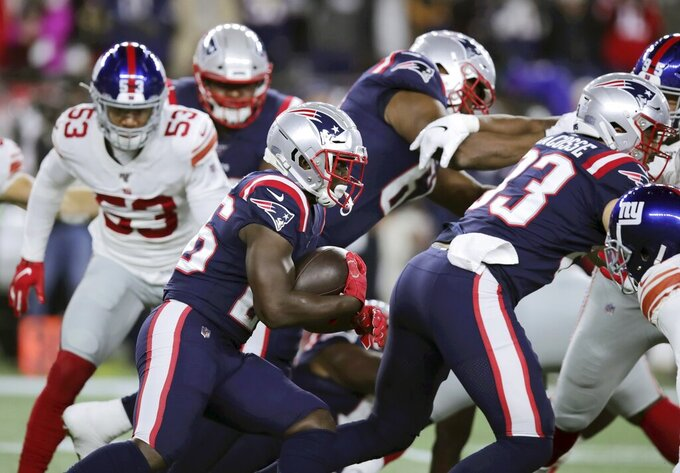 New England Patriots running back Sony Michel, center, carries the ball in the first half of an NFL football game against the New York Giants, Thursday, Oct. 10, 2019, in Foxborough, Mass. (AP Photo/Charles Krupa)