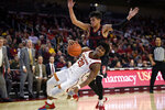 Southern California guard Ethan Anderson falls to the court after being fouled by Stanford guard Tyrell Terry during the first half of an NCAA college basketball game in Los Angeles, Saturday, Jan. 18, 2020. (AP Photo/Kelvin Kuo)