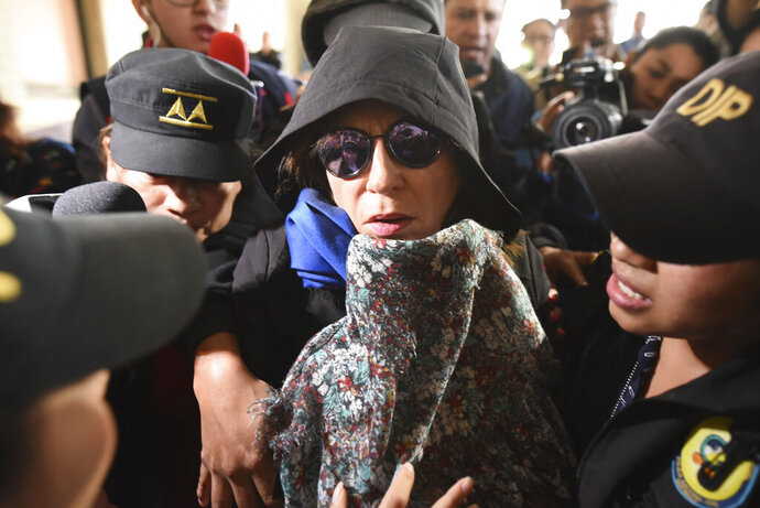 Former first lady and former presidential candidate Sandra Torres is escorted by police to the Supreme Court in Guatemala City, Monday, Sept. 2, 2019. Authorities arrested Torres at her home on charges of campaign finance violations. (AP Photo/Oliver De Ros)