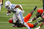 Indianapolis Colts running back Jonathan Taylor (28) tries to break a tackle from Cleveland Browns linebacker Sione Takitaki (44) during the first half of an NFL football game, Sunday, Oct. 11, 2020, in Cleveland. (AP Photo/Ron Schwane)