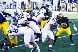 Penn State running back Keyvone Lee (24) rushes for a 6-yard touchdown during the first half of an NCAA college football game against Michigan, Saturday, Nov. 28, 2020, in Ann Arbor, Mich. (AP Photo/Carlos Osorio)