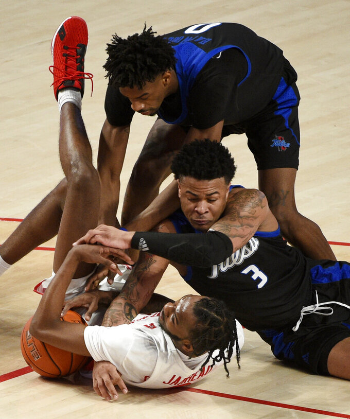 Houston guard DeJon Jarreau, bottom left, and Tulsa's Elijah Joiner (3) and Curtis Haywood II vie for possession of the ball during the second half of an NCAA college basketball game,Wednesday, Jan. 20, 2021, in Houston. (AP Photo/Eric Christian Smith)