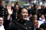 A U.S. Naval Academy midshipmen raises her right hand as she is commissioned as a second lieutenant in the U.S. Marine Corps during the academy's graduation and commissioning ceremony, Friday, May 24, 2019, in Annapolis, Md. (AP Photo/Will Newton)