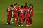 Toronto FC player huddle together before the start of an MLS soccer match against Columbus Crew, Sunday, Sept. 27, 2020, in East Hartford, Conn. (AP Photo/Jessica Hill)