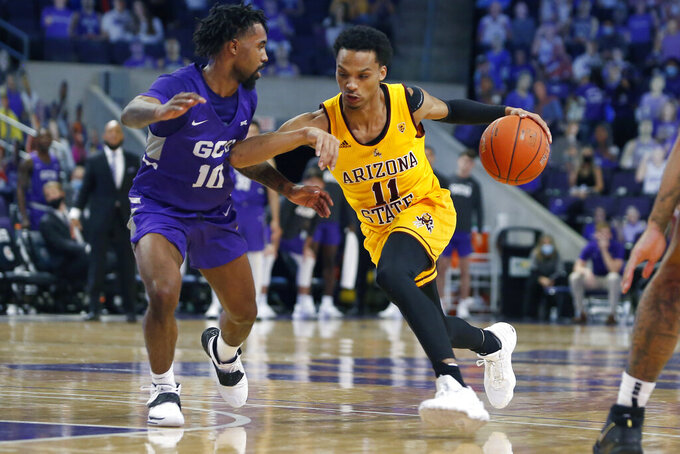 CORRECTS MONTH TO DECEMBER-Arizona State guard Alonzo Verge Jr. (11) drives to the basket as Grand Canyon's Jovan Blacksher Jr. defends during the second half of an NCAA college basketball game, Sunday, Dec. 13, 2020, in Phoenix. (AP Photo/Ralph Freso)