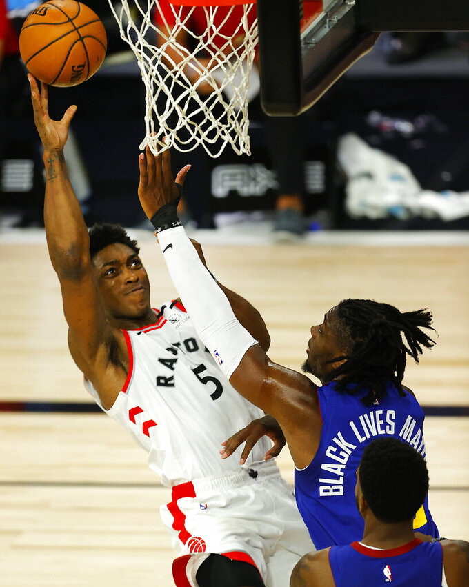 Toronto Raptors' Stanley Johnson (5) drives to the basket against Denver Nuggets' Tyler Cook (25) during the fourth quarter of an NBA basketball game Friday, Aug. 14, 2020, in Lake Buena Vista, Fla. (Mike Ehrmann/Pool Photo via AP)