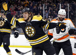 Boston Bruins right wing David Pastrnak (88) celebrates his goal as Philadelphia Flyers defensemen Radko Gudas (3) looks on in the second period of an NHL hockey game, Thursday, Jan. 31, 2019, in Boston. (AP Photo/Elise Amendola)