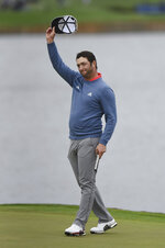 Jon Rahm waves his cap during the final round of The Players Championship golf tournament Sunday, March 17, 2019 in Ponte Vedra Beach, Fla. (Bob Self/The Florida Times-Union via AP)