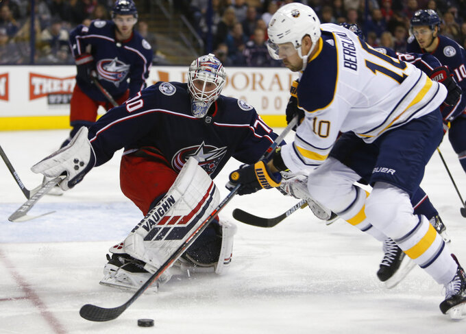 Columbus Blue Jackets' Joonas Korpisalo, left, of Finland, protects the net from Buffalo Sabres' Patrik Berglund, of Sweden, during the first period of an NHL hockey game Saturday, Oct. 27, 2018, in Columbus, Ohio. (AP Photo/Jay LaPrete)
