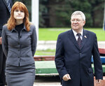 In this photo taken on Friday, Sept. 7, 2012, Maria Butina walks with Alexander Torshin then a member of the Russian upper house of parliament in Moscow, Russia. When gun activist Maria Butina arrived in Washington in 2014 to network with the NRA, she was peddling a Russian gun rights movement that was already dead. Fellow gun enthusiasts and arms industry officials describe the strange trajectory of her Russian gun lobby project, which U.S. prosecutors say was a cover for a Russian influence campaign. Accused of working as a foreign agent, Butina faces a hearing Monday, Sept. 10 in Washington. (AP Photo/Pavel Ptitsin)