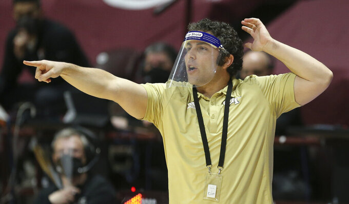 Georgia Tech head coach Josh Pastner points during the first half of an NCAA college basketball game against Virginia Tech Tuesday, Feb. 23, 2021, in Blacksburg, Va. (Matt Gentry/The Roanoke Times via AP, Pool)