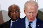 """FILE - In this Feb. 26, 2020 file photo, House Majority Whip, Rep. Jim Clyburn, D-S.C., background, listens as Democratic presidential candidate former Vice President Joe Biden, speaks at an event where Clyburn endorsed him in North Charleston, S.C. """"What I think we need to do now is support this new administration that seems to have leadership as a part of his agenda,"""" said Clyburn, a close ally of Biden. """"We are where we are today because of a lack of leadership and I think that Joe Biden has demonstrated in his articulations that he's prepared to provide the kind of leadership that we need."""" (AP Photo/Gerald Herbert, File)"""