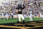 Wake Forest's Alex Bachman (1) celebrates a touchdown during the first half of their NCAA college football game against Pittsburgh on Saturday, Nov. 17, 2018 in Winston-Salem, N.C. (AP Photo/Woody Marshall)