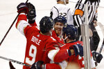 Florida Panthers center Brian Boyle (9) celebrates with left wing Mike Hoffman (68) and defenseman Keith Yandle (3) after Boyle scoreds during the third period of an NHL hockey game against the Los Angeles Kings, Thursday, Jan. 16, 2020, in Sunrise, Fla. The Panthers won 4-3. (AP Photo/Brynn Anderson)