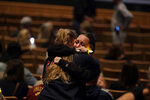 Mourners embrace during a vigil to remember victims of a mass shooting Thursday, Nov. 8, 2018, in Thousand Oaks, Calif. Terrified patrons hurled barstools through windows to escape or threw their bodies protectively on top of friends as a Marine combat veteran killed multiple people at a country music bar in an attack that added Thousand Oaks to the tragic roster of American cities traumatized by mass shootings. (AP Photo/Marcio Jose Sanchez)