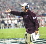 Texas A&M coach Jimbo Fisher gestures during the team's NCAA college football game against Mississippi on Saturday, Oct. 19, 2019, in Oxford, Miss,(Bruce Newman/The Oxford Eagle via AP)