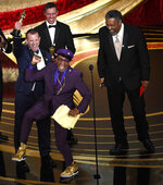 FILE - In this Feb. 24, 2019 file photo, Spike Lee, foreground center, Charlie Wachtel, from left, David Rabinowitz and Kevin Willmott accept the award for best adapted screenplay for