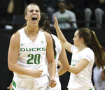 FILE - In this Tuesday, Dec. 18, 2018, file photo, Oregon guard Sabrina Ionescu (20) reacts during an NCAA college basketball game against Mississippi State in Eugene, Ore. Ionescu was named the John R. Wooden Women's Player of the year at the College Basketball Awards ceremony in Los Angeles Friday, April 12, 2019. (AP Photo/Charlie Litchfield, File)
