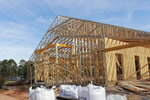 This recent photo shows the construction of a new barn at Storybook Farm in Opelika, Ala. that will be able to house more horses for children to interact with and implement even more hands on activities with the farm's animals. (Jasmyne Ray/Opelika-Auburn News via AP)