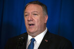 Secretary of State Mike Pompeo delivers a statement on Iraq and Syria, at President Donald Trump's Mar-a-Lago property, Sunday, Dec. 29, 2019, in Palm Beach, Fla. (AP Photo/ Evan Vucci)