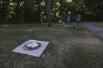 The base of a statue of Frederick Douglass is all that remains, Monday, July 6, 2020 in Rochester, N.Y., after it was found vandalized in Maplewood Park. Police say the statue of Douglass was taken from Maplewood Park and placed near the Genesee River gorge on Sunday. This site includes Kelsey's Landing, a part of the Underground Railroad, where Douglass, Harriet Tubman and others helped slaves get to freedom via the Genesee River located below adjacent gorge. (Tina MacIntyre-Yee/Democrat & Chronicle via AP)