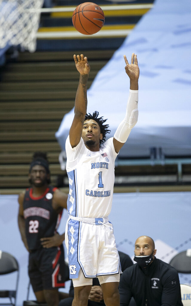 North Carolina's Leaky Black (1) launches a 3-point attempt during the first half against Northeastern in an NCAA college basketball game Wednesday, Feb. 17, 2021, in Chapel Hill, N.C. (Robert Willett/The News & Observer via AP)