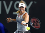 Angelique Kerber of Germany plays a shot during her match against Samantha Stosur of Australia at the Brisbane International tennis tournament in Brisbane, Australia, Monday, Jan. 6, 2020. (AP Photo/Tertius Pickard)