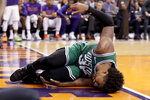 Boston Celtics guard Marcus Smart (36) lies on the court after being injured during the second half of an NBA basketball game against the Phoenix Suns, Monday, Nov. 18, 2019, in Phoenix. Smart left the game. (AP Photo/Matt York)