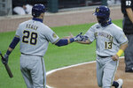 Milwaukee Brewers' Mark Mathias, right, celebrates with Ryon Healy after scoring on a one-run single by Eric Sogard during the third inning of a baseball game against the Chicago White Sox in Chicago, Wednesday, Aug. 5, 2020. (AP Photo/Nam Y. Huh)
