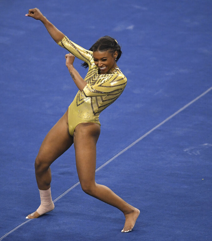 UCLA Bruins gymnast Nia Dennis competes in the floor exercise against BYU during a gymnastics meet in Pauley Pavilion on the campus of UCLA in Los Angeles on Wednesday, Feb. 10, 2021. (Keith Birmingham/The Orange County Register via AP)