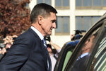 FILE - In this Dec. 1, 2017, file photo, former President Donald Trump national security adviser Michael Flynn leaves federal court in Washington. The Justice Department's dismissal of the Michael Flynn case has been swept up in a broader push by President Donald Trump and Republican allies to reframe the Russia investigation as a plot to sabotage his administration. (AP Photo/Susan Walsh, File)