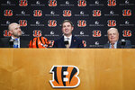 Cincinnati Bengals football head coach Zac Taylor, center, speaks alongside Bengals owner Mike Brown, right, and Duke Tobin, Bengals director of player personal, during a news conference, Tuesday, Feb. 5, 2019, in Cincinnati. After 16 years without a playoff win under Marvin Lewis, the Bengals decided to try something different. But they had to wait more than a month before hiring Zac Taylor as their next coach in hopes of ending a long streak of futility. (AP Photo/John Minchillo)