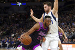 Minnesota Timberwolves' Josh Okogie, left, of Nigeria, drives into Dallas Mavericks' Luka Doncic, of Slovenia, in the first half of an NBA basketball game Friday, Jan. 11, 2019, in Minneapolis. (AP Photo/Jim Mone)