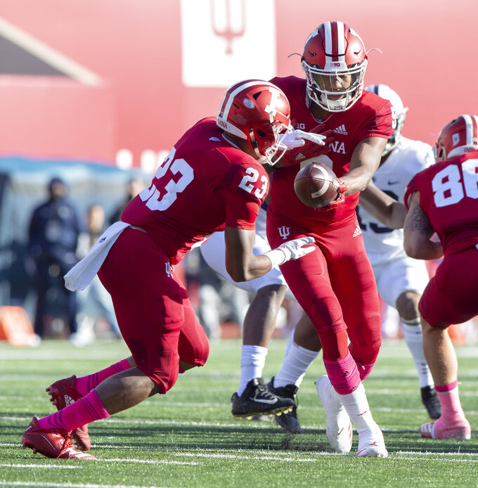 Indiana quarterback Michael Penix Jr. (9) hands the ball off to Indiana running back Ronnie Walker Jr. (23) in the backfield during the first half of an NCAA college football game against Penn State Saturday, Oct. 20, 2018, in Bloomington, Ind. (AP Photo/Doug McSchooler)